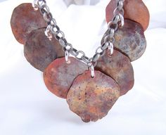 Rustic Copper Modified Penny Necklace. * Put a penny on a very hard surface, and flatten it with a hammer! Way Cool!