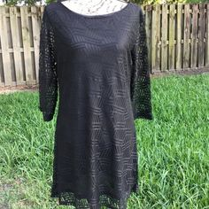 Stunning g black shift dress You can't go wrong with this dress by MT. Collection. Sheer patterned overlay, lined and sleeves are sheer. Measures 34.5 inches shoulder to hem, 18 inches across the bust and  18 inches across the hips. MT Collection Dresses Midi