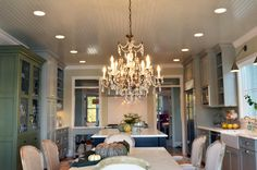kitchen, mix of cabinet colors, chandelier