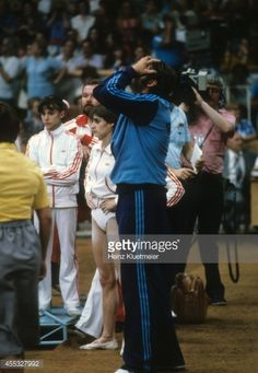 View of Romania Nadia Comaneci and coach Bela Karolyi (R) upset after results are announced during Women's event at Sports Palace of the Central Lenin Stadium. Heinz Kluetmeier X24708 TK5 R51 F24 )