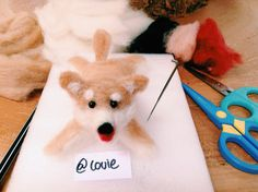 Felt wool or needle felting. This is a shiba inu.