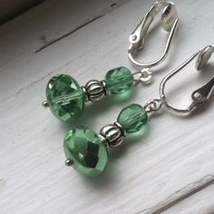 A personal favorite from my Etsy shop https://www.etsy.com/listing/187354102/simple-green-and-silver-drop-clip-on