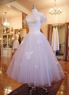 1950's Cahill tea-length wedding dress--that's not a creepy little elbow, it's a pink velvet chair in the back ground