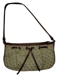 Dooney & Bourke Leater Canvas Monogram Green / Brown Baguette. Get the trendiest Clutch of the season! The Dooney & Bourke Leater Canvas Monogram Green / Brown Baguette is a top 10 member favorite on Tradesy. Save on yours before they are sold out!