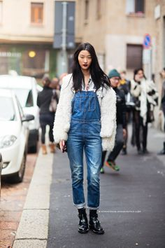 Fitted overalls with a fuzzy sweater + biker boots // #StreetStyle #Fashion