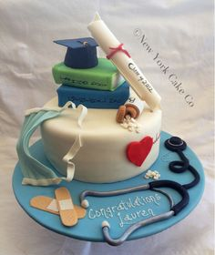 Everything is edible, only fondant, buttercream and cake. Textbooks and hat are also cake. Scroll is hand painted.