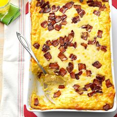 Baked Two-Cheese & Bacon Grits Recipe -In the South, everyone loves three things: bacon, cheese, and grits! After playing around with this recipe, I took it to my first family party as a newlywed and it was a huge hit. This recipe has become a family tradition that will hopefully be passed down for generations. —Melissa Rogers, Tuscaloosa, Alabama