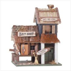 "Bass Lake Birdhouse.  Multi-level ""Bass Lake Lodge"" sports fishing-themed accents reminiscent of a lakeside retreat.  8"" x 5 3/4"" x 10 1/4"" high."
