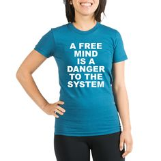 Women's dark color galaxy blue fitted t-shirt with A Free Mind Is A Danger To The System theme. In order to rule the masses programming, conditioning, brainwashing, distraction, fake news, etc are used. Once your mind is free you are free. Available in galaxy blue, pomegranate; small, medium, large, x-large for only $27.99. Go to the link to purchase the product and to see other options – http://www.cafepress.com/stfree