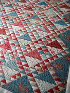 I like the quilt but mostly I want to remember this quilting pattern! Great idea for HSTs