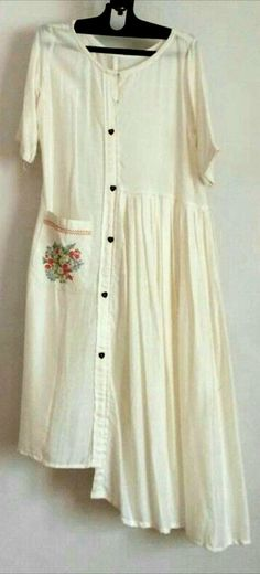Cotton Kurti with brilliant detailing with embroidered pocket , buttons and pleats.
