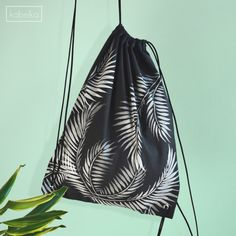 If you don't have time to DIY Drawstring Bag-Backpack-Black Painted Bag-Tropical by kabelkashop If you are in love with sports, but you want to be stylish at the same time, than this bag will be your best choice. Whether if you go to the gym or go to school or just for a walk it can be easily paired with any style.   The bag and the printings are all hand made, and every piece is unique because the location of the prints are always different.