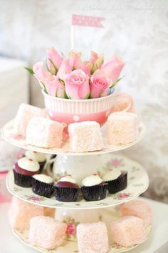 I love this set up! a big tea cup with roses in it for a center piece