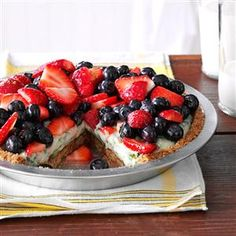 Creamy Lime Pie with Fresh Berries Recipe -I combined the tangy taste of lime and cilantro with cream cheese for this unusual berry pie that showcases seasonal fruit. The ginger cookies add zip to the crust. —Anneliese Barz, Fort Mill, South Carolina