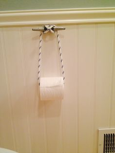 "Boat cleat toilet paper holder - 3 ft of 5/16 rope - 1 6"" cleat w/two hooks to hook together that get hidden in the paper roll - super easy for coastal/nautical bathroom"