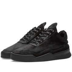 Amsterdam based brand Filling Pieces do exactly what their name intends- fill a gap in the footwear market between street and haute couture, with minimal design and impeccable detailing through high quality product. The Low Top Sneaker is constructed from a premium Italian nubuck, waxed in a matte black, finished with a full leather lining and edge shaped finish on the down strap to ensure a sleek silhouette. The sneaker sits atop a 'Ghost' sole unit.  Italian Leather Uppers Waxed Matte…