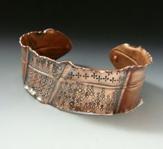 A darling balance of fold forming, stamping, and the oxidization of copper!