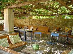 Wine under the wisteria.