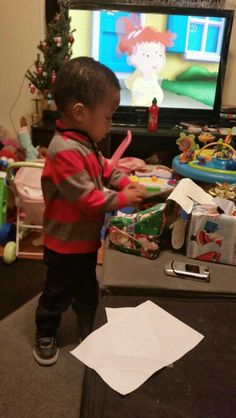 Mar Mar opening up his Christmas gifts from Ms.Ann'sChildcareofBaltimore