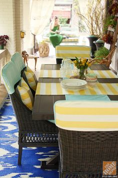 Give your dining set a custom look by adding slipcovers. These turquoise and yellow slipcovers were designed by Grace of A Storied Style blog and lend so much personality to the Woodbury Dinig Set.
