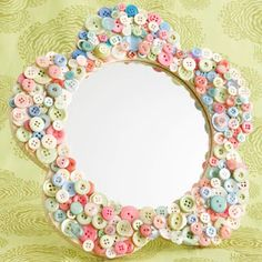 BUTTON ART: Darling Button Covered Mirror. Get the mirror at the craft store. Perfect for a little girl's bedroom