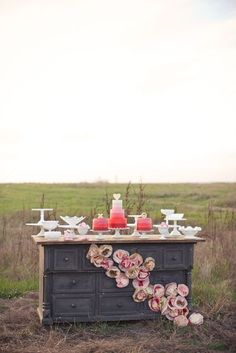 Not only is this a gorgeous photo, but I love the vibrant pinks and the cascading paper flowers down the buffet!