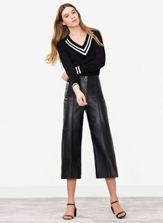 Doña Letizia sported a contemporary look consisting of black culotte pants made of nappa leather with an exposed front zipper. The limited edition trousers are from Uterque's Spring/Summer 2016 collection in retail for €275. 35th ARCO International Contemporary Art Fair, Ifema, Madrid, Spain. 2.25.2016.