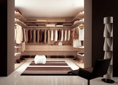 Divide closet into sections: clothing, shoes, accessories, and makeup/ dressing area. The middle will be a sitting area