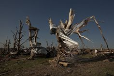 In Focus : Mathieu Asselin   One Life 2011. On May 22, 2011 the deadliest tornado in the United States since 1947 drove through the city of Joplin, Missouri, killing 161 people, obliterating 8,000 buildings and ultimately causing $2.8 billion in damages.  Mathieu Asselin is the Grand Prize Winner of the 2011 One Life Photography Competition.