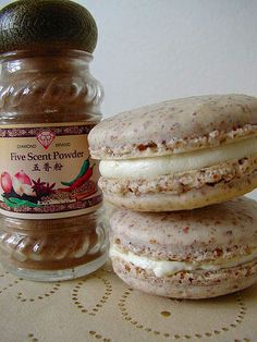 pineapple & five spice macarons. by 90/10, via Flickr -- I like this variation idea of the almond/5-spice theme! :D