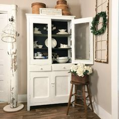 How I decorate with architectural salvage pieces by CountyRoad407.com #ArchitecturalSalvage #Upcyling #repurposed #HomeDecor #CountyRoad407 #LifestyleOfLove Antique Hutch, Antique Plates, China Cabinet Display, Vintage Globe, Farmhouse Chandelier, Cottage Style, Cottage Living, Farmhouse Style, Vintage Iron