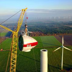 The newest Enercon wind turbine under construction. Nacelle mounting.  #windpower #windkraft #energie #energy #windturbine #windmill #windenergy #wind #turbine #windfarm  #repowering #construction #crane #nacelle #tower #site #renewable #cleanenergy #dronestagram #drone #view #photo #green #climatechange #sunset #dronestagram #dronephotography