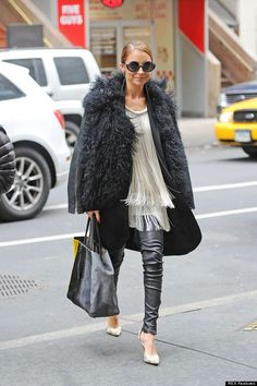 Nicole Richie - snug-looking shearling coat worn over a Flapper Girl-style fringed cream top, paired with leather trousers, which, we're sure, could be a bit more fitted. The round sunglasses made an oh-so-fashionable finish.