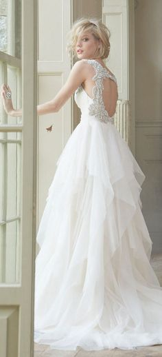 Hayley Paige bridal gown with draped sweetheart bodice, tiered flounce skirt…