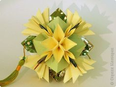 Kusudama: Asterix.  Tutorial (part 2).  on step 5 fold the creases made in step 4 to the back center line