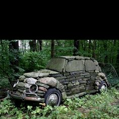 Stone VW, in a field near Ithaca, NY. Made in 1976 by Cornell art class  whose professor felt art should be found anywhere.