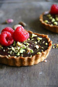 dark chocolate, raspberry and pistachio tartlets