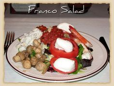 Franco Salad With shrimp, buffalo mozzarella, sliced tomatoes, roasted peppers, marinated mushrooms, fresh basil, and jumbo lump crabmeat #BravoFrancoRistorante #BravoFranco #ItalianCuisine #Italian #Food #Dinner #Restaurant #Pittsburgh #PA #Menu #FineDining