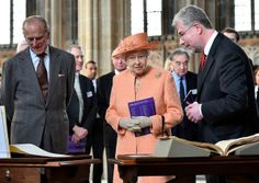 Britain's Prince Philip, Duke of Edinburgh and Britain's Queen Elizabeth II are shown a Royal College of Organists manuscript dating back to 1750 by Royal College of Organists Director of Academic Development, Andrew McCrea (R), during a visit to commemorate the RCO's 150th anniversary at St. George's chapel at Windsor Castle in Windsor, west of London, on April 9.