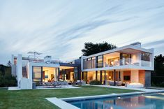 This modern waterfront property was designed by Blaze Makoid Architecture, located in North Haven, a village in Suffolk County, New York. Casas Containers, Building A Porch, Modern Mansion, Waterfront Property, House With Porch, Luxury Homes, Architecture Design, Mansions, House Styles