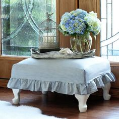 Update an old footstool with a removable and washable slipcover using this sew easy tutorial!