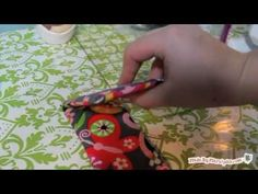 iPod or iPhone Case Stand. Prop up your iPod or iPhone on this DIY gadget cover. It's padded for protection and even snaps like a wallet! #video #tutorial #sewing