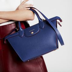 6da826566be75 Dive deep into style this Spring with the indigo blue Le Pliage Héritage.