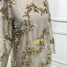In store today, a subtle silver organza tunic with gold and pearl diagonal vines - #MuseLuxeWedding