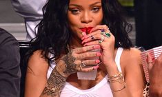 Rihanna wearing Jacquie Aiche rings, cuffs and necklaces and Alison Lou Screw U cuff.