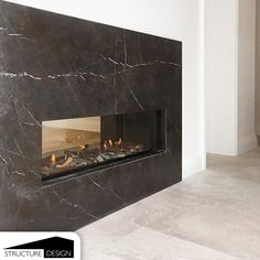 A bespoke fireplace designed to create a unique visual scene in the interior by creating a connection between the kitchen and a private relaxation room. Relaxation Room, Fireplace Design, Portfolio Design, Bespoke, Connection, This Is Us, Scene, Lighting, Create