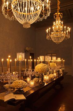Crystal chandeliers are matched by small votives and candelabras for a touch of natural light.