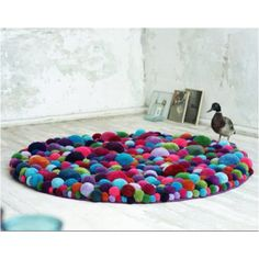 Rug made of giant soft pom poms! I would love this in the baby's room