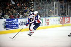 John Mitchell skates into the offensive zone.
