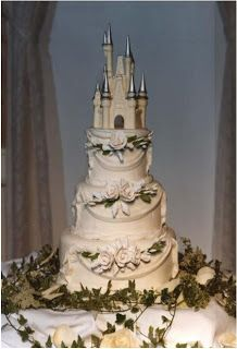 A true fairy-tale wedding cake in white and silver with a Cinderella's castle cake topper.